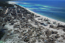 Aerial View Of Devastated Fishing Village After Cyclone Kenneth
