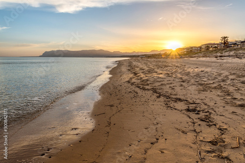 Sunrise on the beach of Alcamo Marina in Sicily, Italy Wallpaper Mural