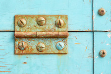 Rusted Hinge And Faded Blue Pa...