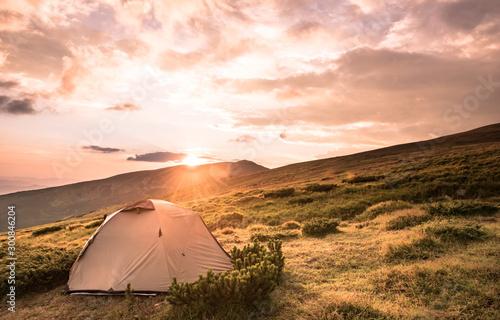 Foto auf Leinwand Lachs Camping tent in morning sun ray. Active lifestyle. Tatra mountains Zakopane, Poland