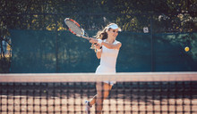 Woman Forcefully Playing Tennis