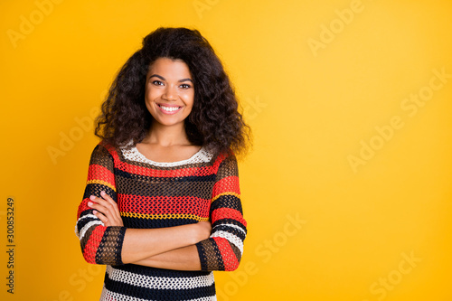 Portrait of her she nice attractive lovely charming cute pretty cheerful cheery wavy-haired girl wearing knitted sweater folded arms isolated over bright vivid shine vibrant yellow color background