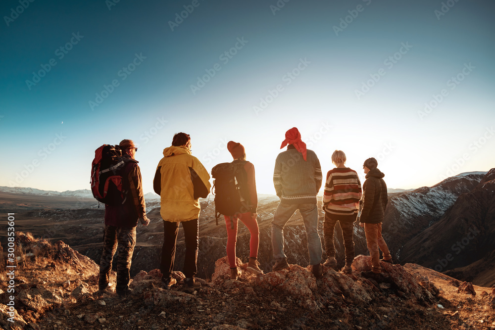 Fototapety, obrazy: Group six tourists against sunset light and mountains