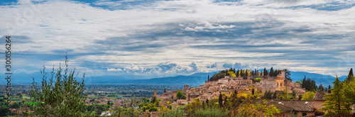 Panoramic view of Spello medieval hisitoric center and Umbria countryside with beautiful clouds above