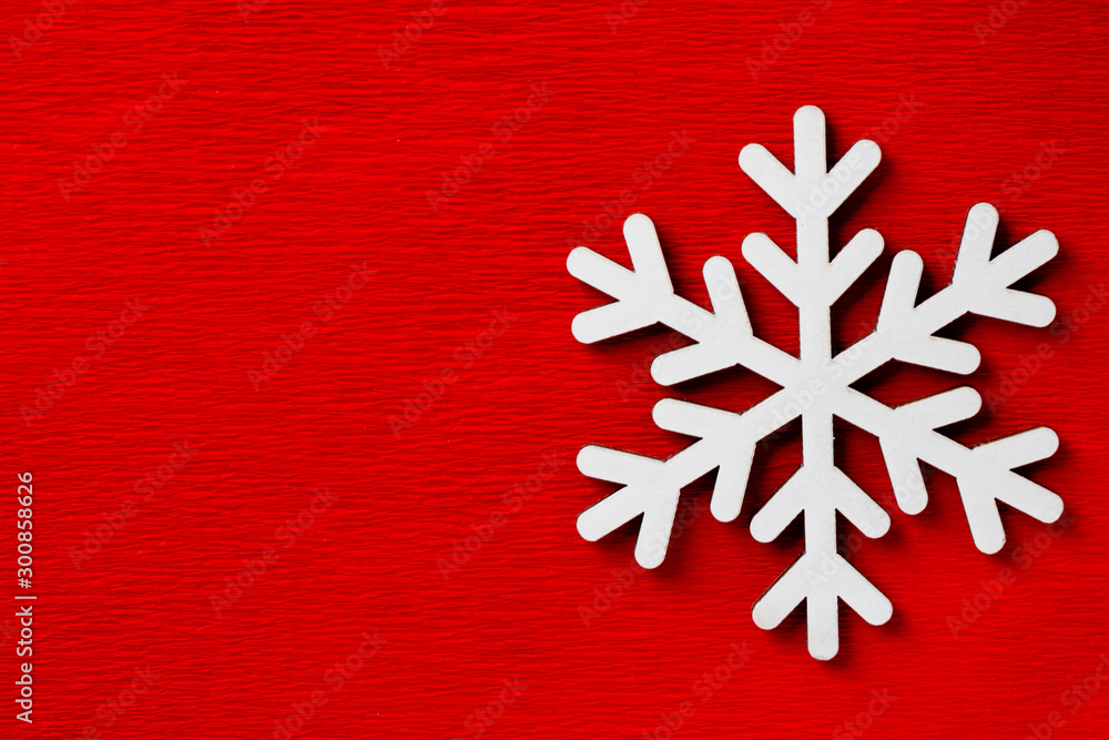Fototapety, obrazy: Christmas New Years decoration wooden white snow flake on twine on red velveteen background. Creative holiday greeting card poster banner template with copy space