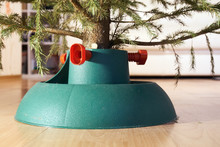 Plastic Stand With A The Christmas Tree Stands On The Floor In City Flat In New Year Eve