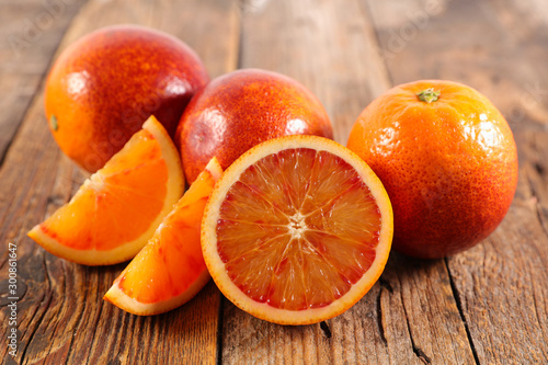 bloody orange on wood background - 300861647