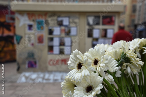 Photo People have laid white flowers in tribute to the eight victims of the collapse o