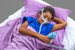 canvas print picture - Child suffering from Sleep Apnea, wearing a respiratory mask.