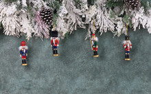 Christmas Background With Fir Branches And Christmas Nutcracker