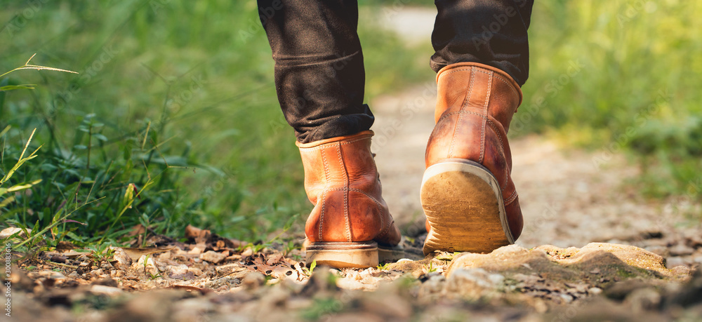 Fototapety, obrazy: Feet Man hiking outdoor and forest on background Lifestyle Travel survival concept