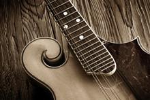 Vintage Bluegrass Mandolin On Aged Wood