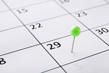 Planning Calendar With Green Pin Close Up. Important Date. Place For Text. Planning Concept.