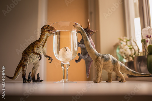 3 dinosaurs amazed with a view of baby dinosaur hatching from an egg Wallpaper Mural
