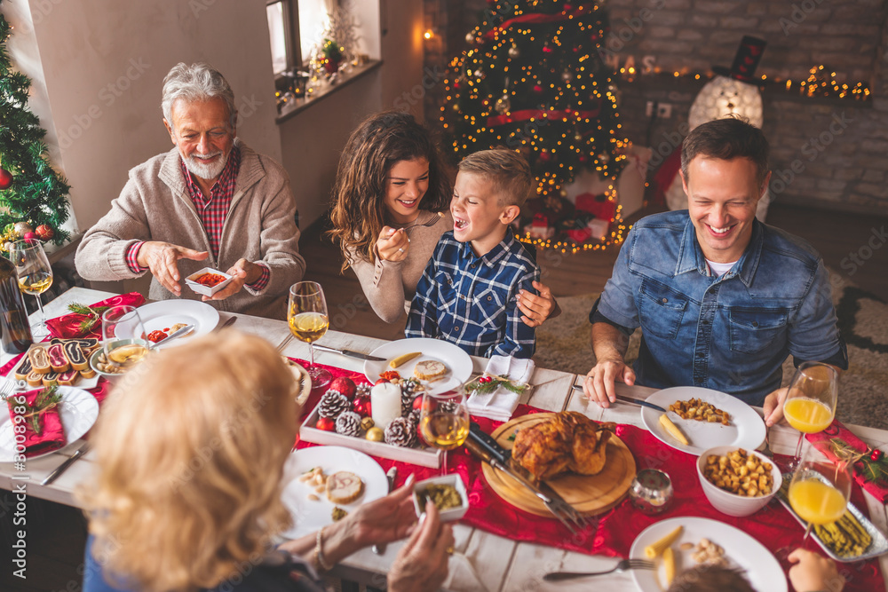 Fototapety, obrazy: Happy family having Christmas dinner