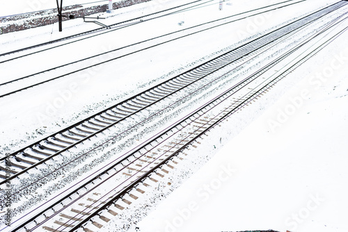 Spoed Foto op Canvas Spoorlijn Rail tracks in the snow