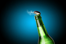 Cold Wet Bottle Of Chilled Drink With Drops. Opening Of Beer Cap With The Gas Output.