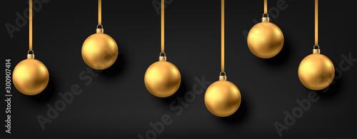 Golden  hanging Christmas balls isolated on black  background. Fototapet
