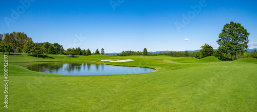 Photo sur Toile Pistache Golf Course with beautiful green field. Golf course with a rich green turf beautiful scenery.