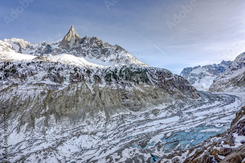 Clear view of Aiguille du Dru with glaicer and ice cave at the bottom near Chamo Canvas Print