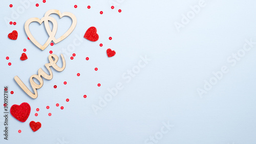 Fototapeta Valentine's Day concept. Flat lay wooden sign