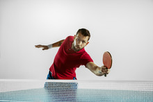Emotions. Young Man Plays Table Tennis On White Studio Background. Model Plays Ping Pong. Concept Of Leisure Activity, Sport, Human Emotions In Gameplay, Healthy Lifestyle, Motion, Action, Movement.