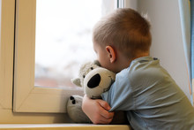 Sad Boy At The Window And Bear Toy, Loneliness And Depression