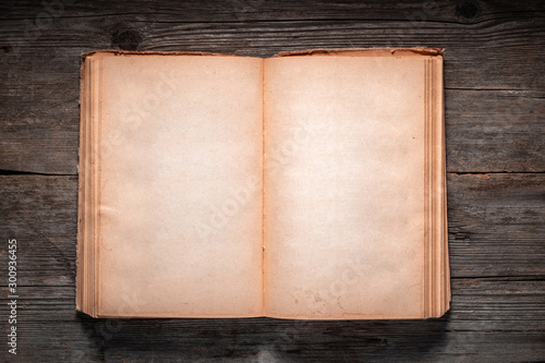 Obraz Vintage book, open, on old wooden table, with clipping path. Open Book blank on old wooden background. book with blank pages - fototapety do salonu