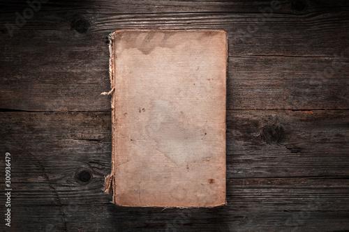 Fotomural  Closed book on vintage wooden background