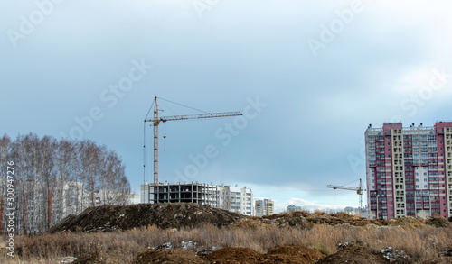 construction cranes on the construction site new residential area Wallpaper Mural