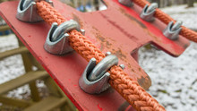 Close Up Of Red Rope And Metal...