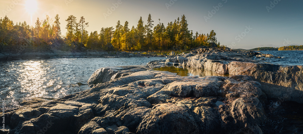 Fototapety, obrazy: Beautiful panorama of a rocky shore. Nordic sunrise or sunset.  Close-up of  big stones