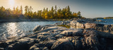 Fototapeta Kamienie - Beautiful panorama of a rocky shore. Nordic sunrise or sunset.  Close-up of  big stones