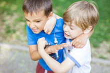 Two Boys Fighting Outdoors. Siblings Rivalry.
