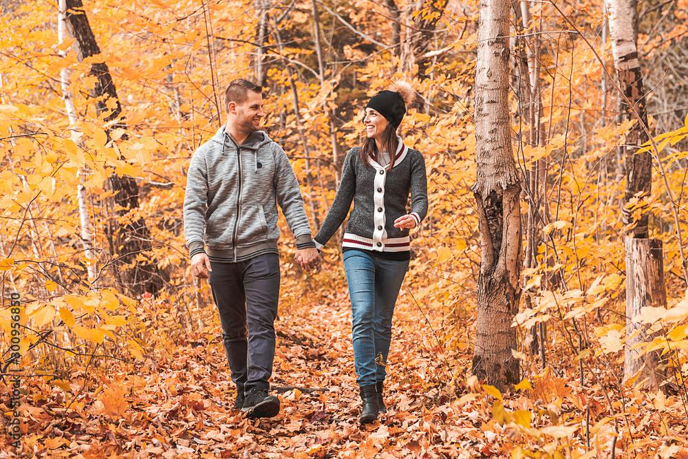 Fototapeta happy autumn fall couple in a park