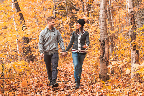 happy autumn fall couple in a park