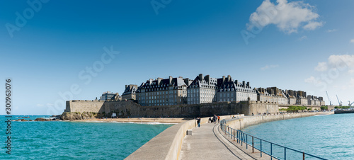 Fotobehang Noord Europa historic French town of Saint-Malo in Normandy seen from the harbor wall jetty