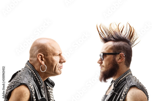 Fotografija Young punker with a mohawk and an older bald punker looking at eachother