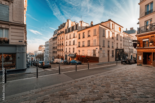 Streets of the Montmartre Quarter in Paris, France. Morning light with blue sky. #300964630
