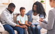 canvas print picture - Little black girl and her parents at psychologist consultation