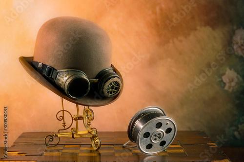 Fototapeta Steampunk del cinema con cappello e pellicola