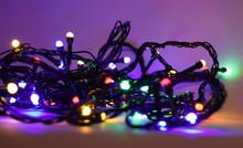 Colorful Tangled Christmas Lights On Dark Background
