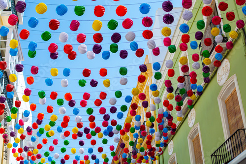 Foto auf Leinwand Altes Gebaude Colorful decoration with paper balls on streets in old part of ancient town Ronda, Andalusia, Spain