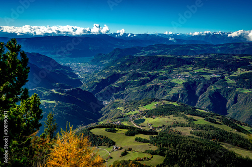 Foto auf AluDibond Blaue Nacht View from the Voelsegg mountain south overlooking Proesels and Oberaicha village to the Eisacktal valley and the town Bozen on a bright autumn day with Unterinn and Oberbozen in the background
