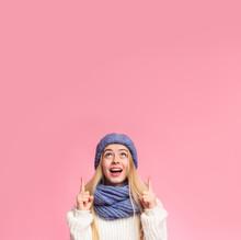 Amazed Girl In Blue Hat Pointi...