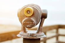 Beach Telescope For Tourists With The Words Focus And Warm Lighting