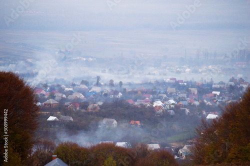 Panoramic view on fog village, Carpathian mountains, Ukraine. Horizontal outdoors shot