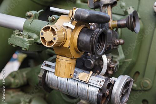Part of the sighting mechanism of artillery gun. Close up Wallpaper Mural