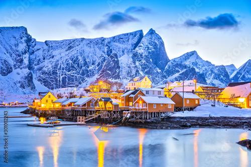 Fotografija Sakrisoy village on Lofoten Islands in Norway, beautiful twilight view with street lamp reflections during winter season