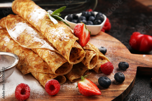 Delicious Tasty Homemade crepes or pancakes with raspberries and mint on rustic Wallpaper Mural